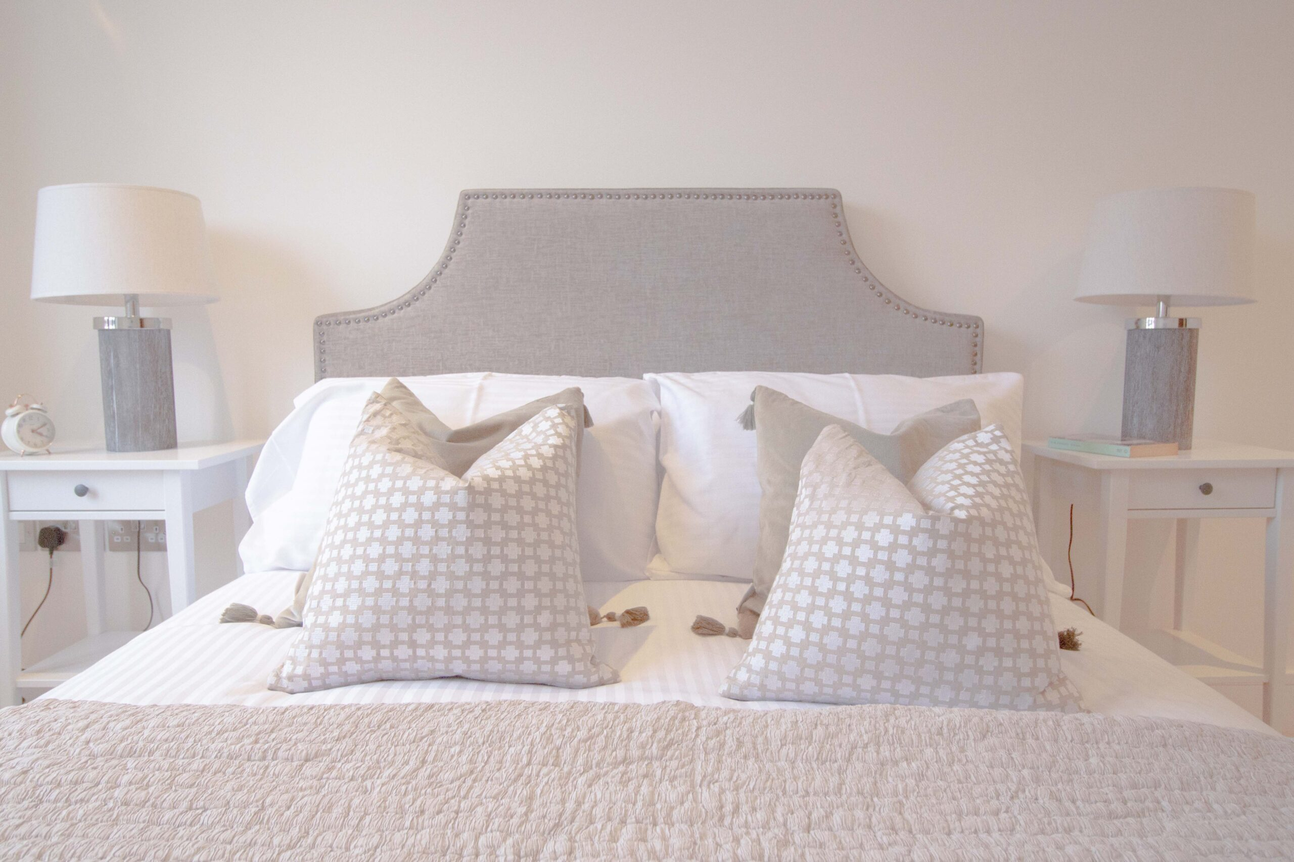 Bed with cushions and throw
